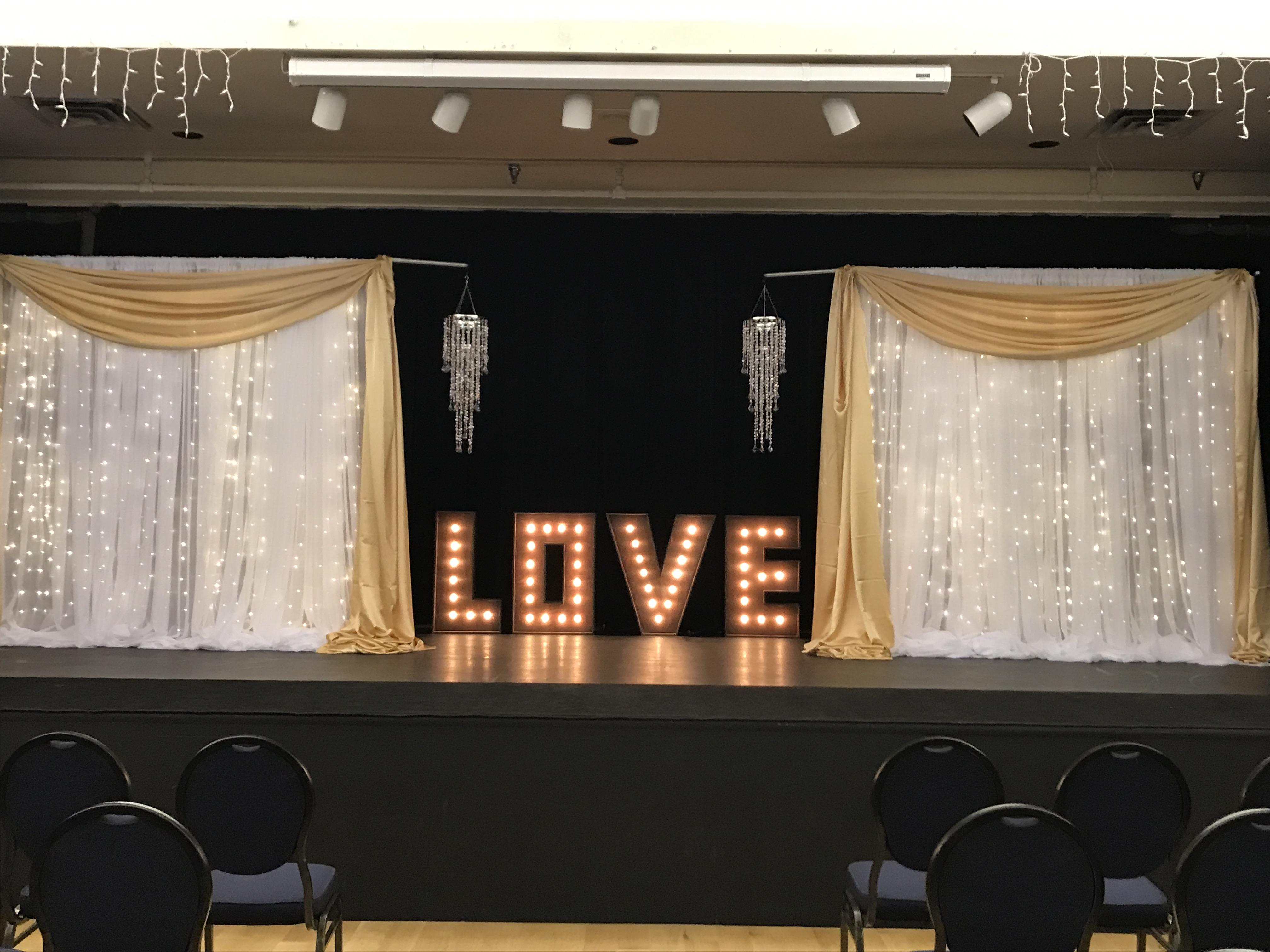 Gold Valance With Lite Backdrop On Stage W Love Sign